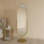 Овальное напольное поворотное зеркало на подставке в золотой металлической раме Мариус